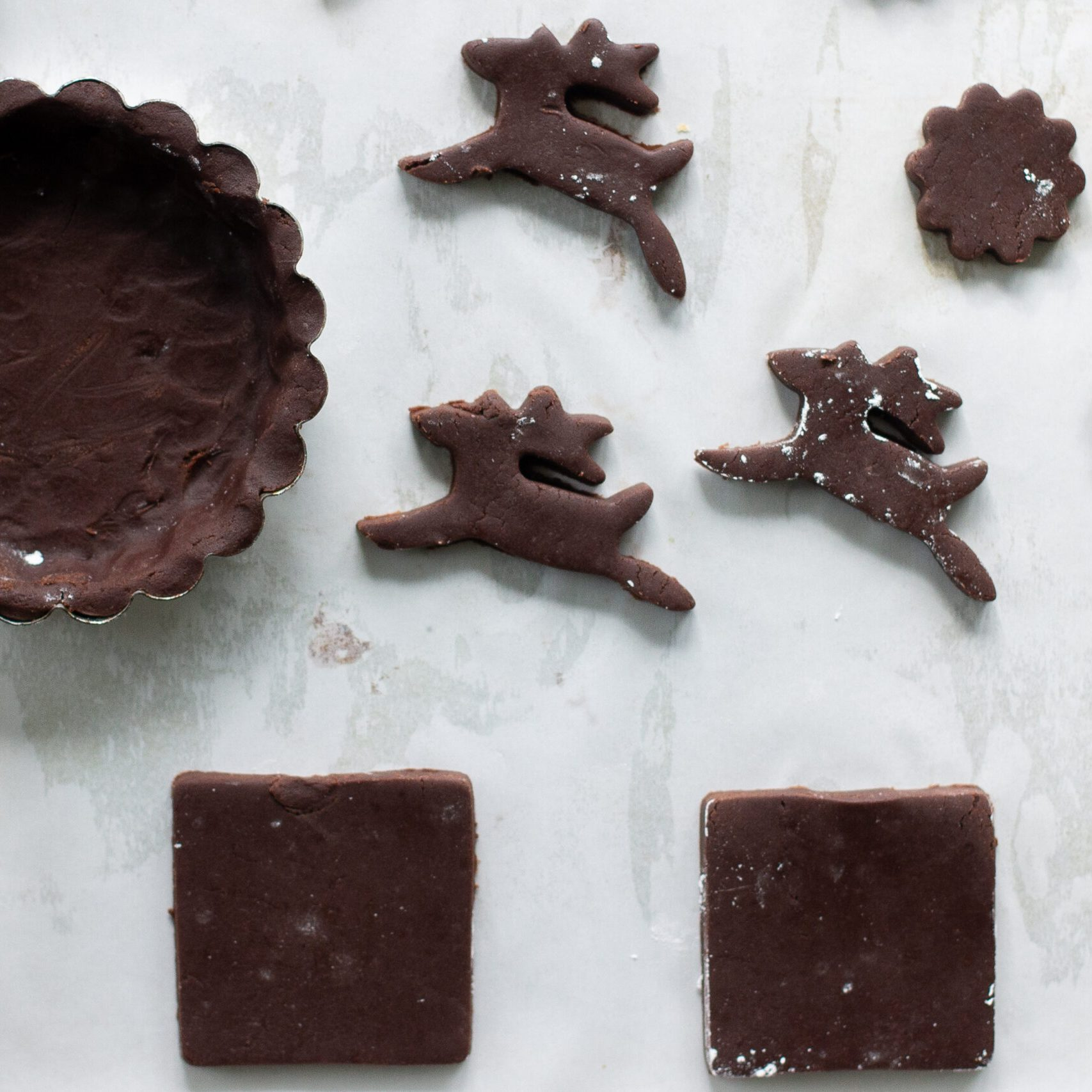 Cutting and shaping chocolate shortbread.