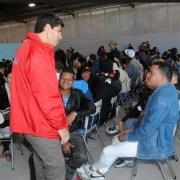 Última semana para que migrantes inicien trámite de regularización en Estadio Municipal de Cavancha
