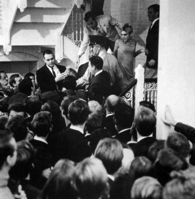 "Teatime on Mars: Black-and-white photograph of an SRO crowd chanting ""Edie and Andy!"" as they press against the stars who retreat up a spiral staircase."