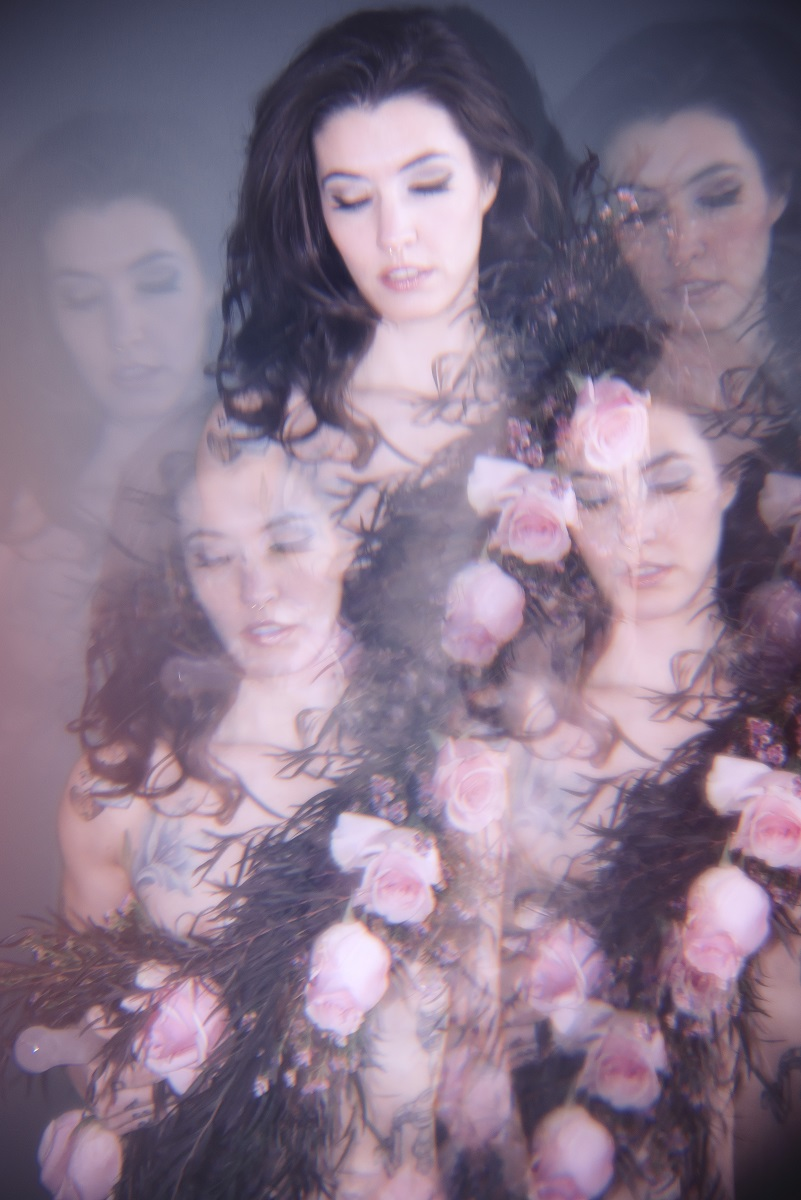kaleidoscope photograph of a white brunette wearing a rose and leaf garland.