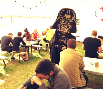 Darth Vadar doing card tricks at breakfast