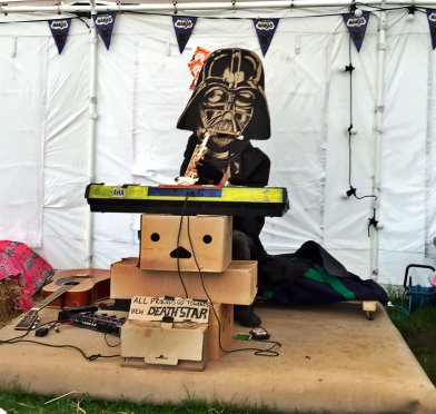 Darth Vadar on sax and keyboards raising money for the new Death Star at Edinburgh Festival and Fringe Camping