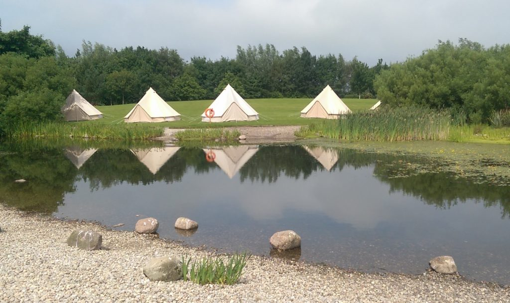 Glamping Bell Tents over pond Edinburgh Festival Camping