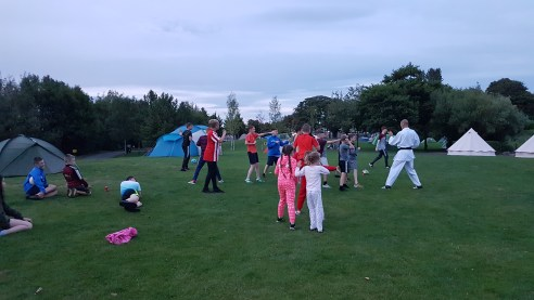 A customer leading a Taekwondo lesson to children on site