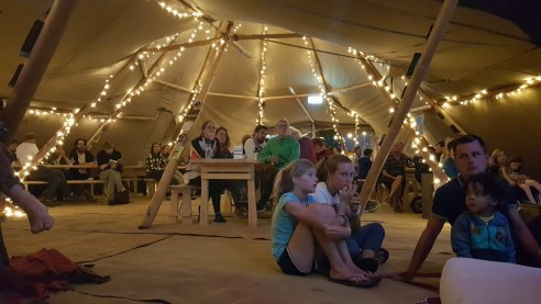 More guests enjoying the performers in the tipis