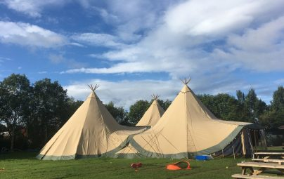 The Tipis and outside play area at Edinburgh Festival Camping