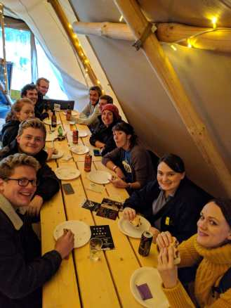 Our crew enjoying Burger Night in the Giant Tipis!