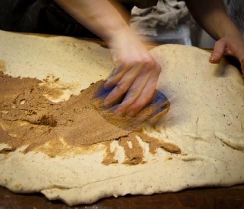 Adding the cardamom bun filling