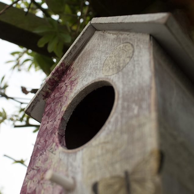 Decorated wooden birdhouse
