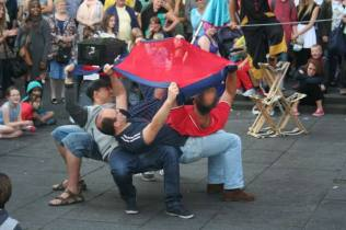 Human Safety Net for Juggling Fire Act at Edinburgh Fringe