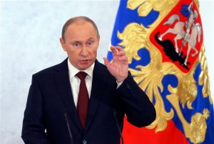 Russian President Vladimir Putin speaks during a state-of-the nation address in Moscow, Russia (Alexander Zemlianichenko/AP)