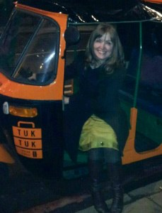 owner of the two luxury Edinburgh apartments sitting in tuk tuk in Edinburgh