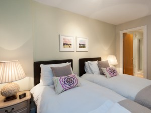 superking or twin edroom in linens and pale greens, The Botanist Apartment Edinburgh (formerly named the Parkgate Residence)