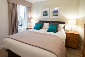 King Size Bedroom in blues and greens and wool tartan
