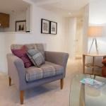 McDonald Residence living room showing plaid wool chair