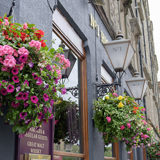 High Street Bar, with floral hanging baskets Royal Mile Edinburgh