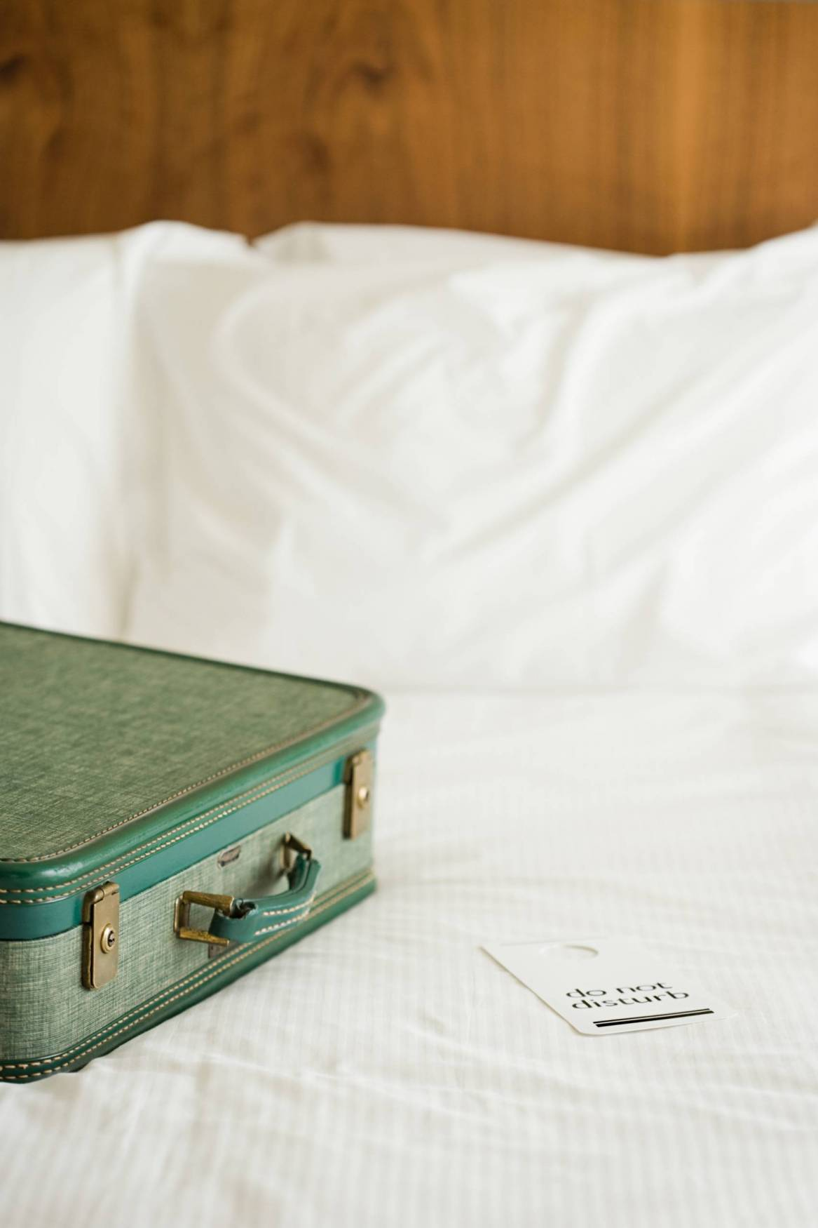 Canva Suitcase On Hotel Bed Scaled