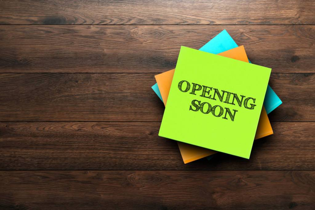 Canva Opening Soon The Phrase Is Written On Multi Colored Stickers On A Brown Wooden Background. Business Concept Strategy Plan Planning. Scaled