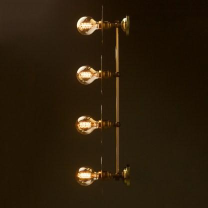 Four globe brass wall mount 180mm disc light side