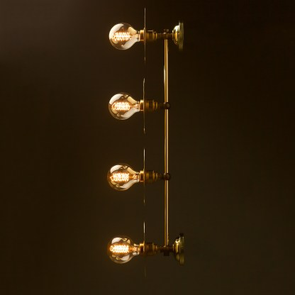 Four globe brass wall mount 180mm disc light side