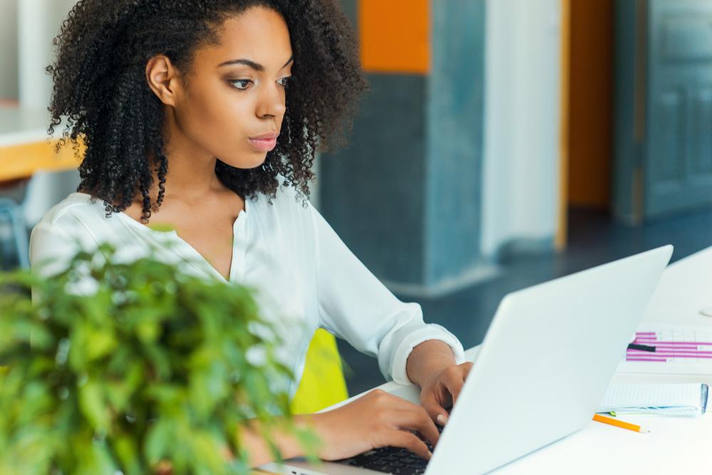 Diverse woman on laptop