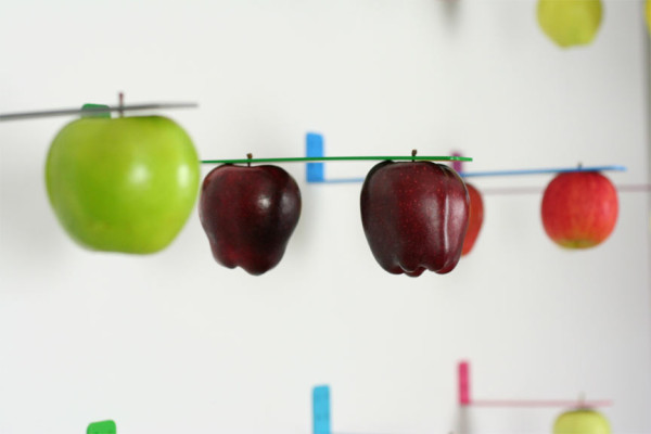 Apple holder designed to mimic the experience of apple picking