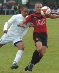 James Chester is closed down by Matt Walwyn (copyright Blackpool Gazette)