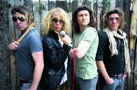 Justin Hawkins, second from left, with the rest of Hot Leg