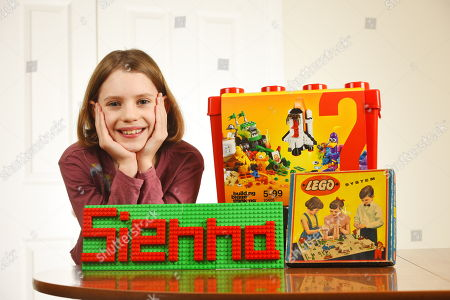 9yearold becomes worlds youngest Lego designer London Stock Photos     Sienna Rice with various LEGO sets over the years and her own LEGO name  plate