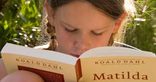 Famous Authors Series – Roald Dahl photo of girl reading Matilda