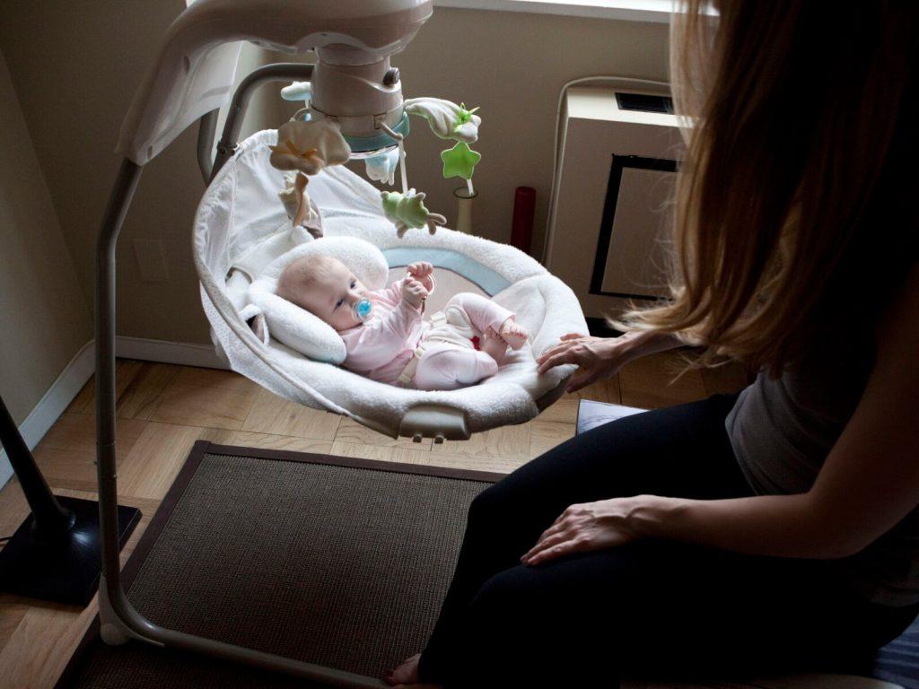 mother-rocking-baby-in-swing-156266769-5c191b85c9e77c00011c3d53