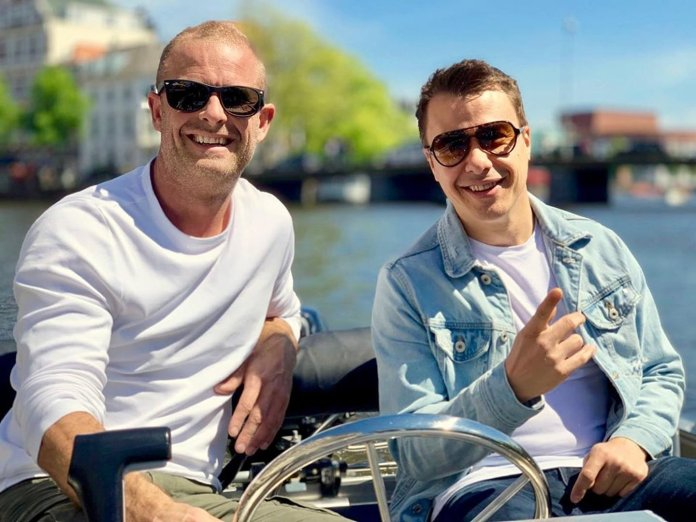 Ben Gold and Richard Durand in a boat in Amsterdam