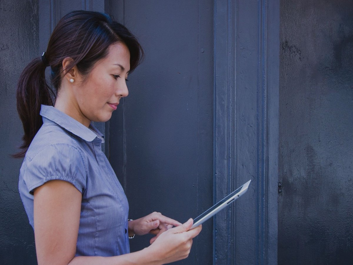 female business owner using tablet