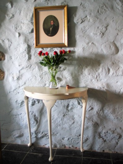 white vintage side table with roses