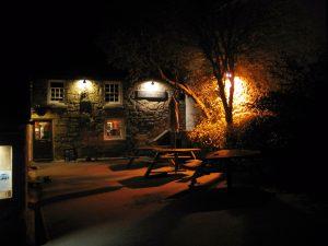 atmospheric cornish pub after dark