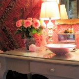 opulent silk hanging backs a dressing table in a vintage style bedroom at Ednovean Farm