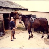With a young horse Sooty outside what is now the Blue room