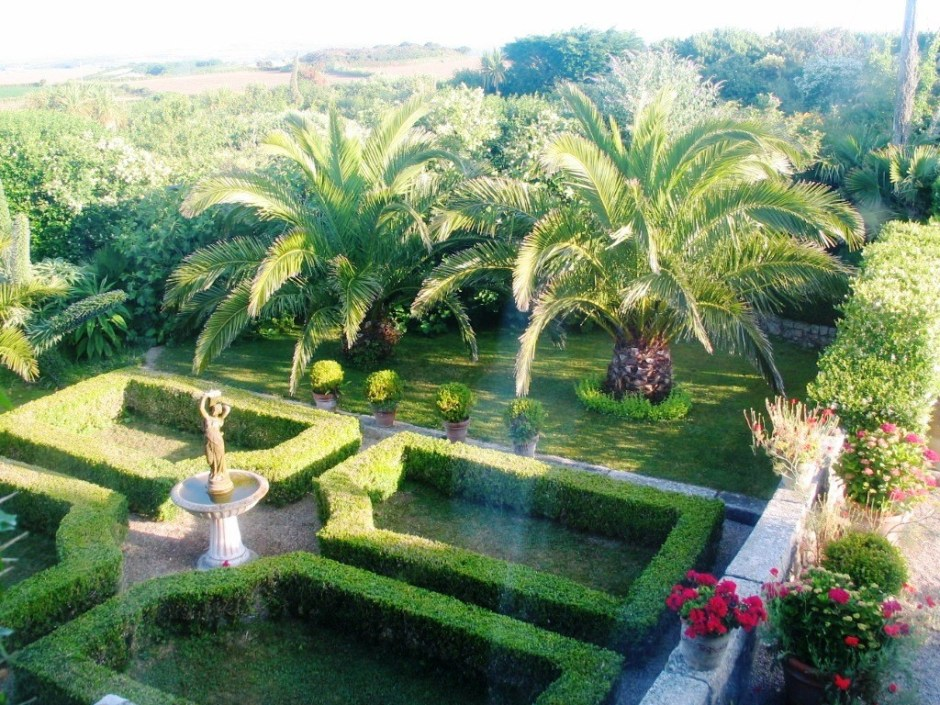 View over formal Parterre and sub tropical planting
