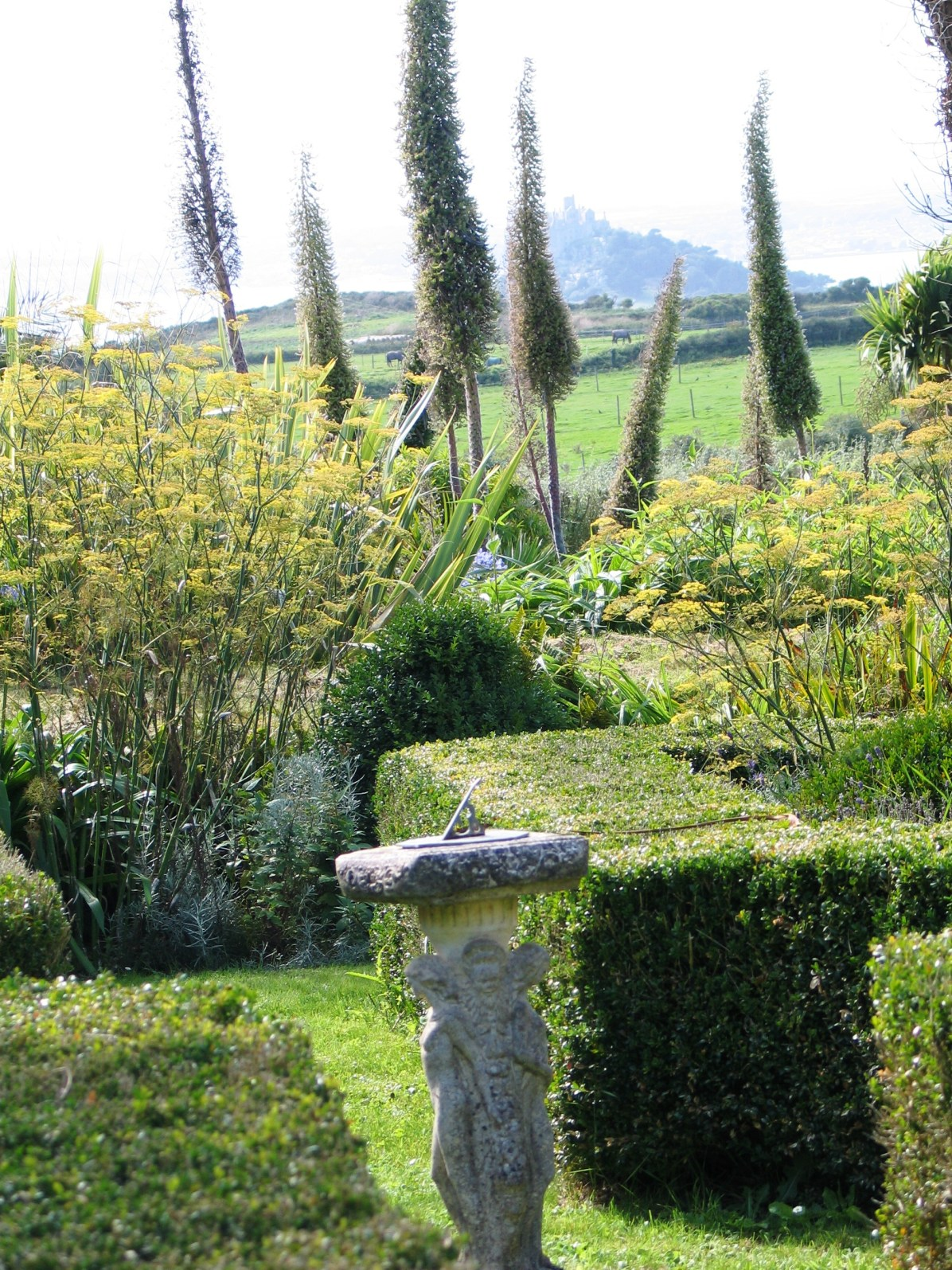 The sundial garden in front of the Apricot bedroom looks down towards ST Michael's Mount