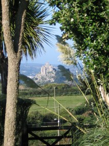 St Michael's mount in west cornwall framed by a garden gateway