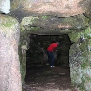 Charles exploring the underground beehive hut