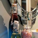 pretty glass bottle hold toiletries in the Blue bedroom's ensuite