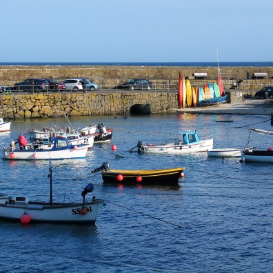 Parking below the harbour walls but beware in stormy weather!
