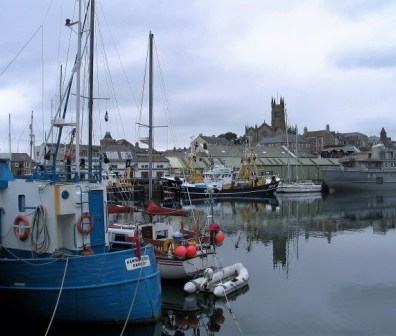Sea town and sky in reflections in Penzance harbour