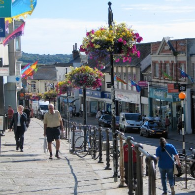 The raised granite terrace of market jew street in Penzance full of flowers