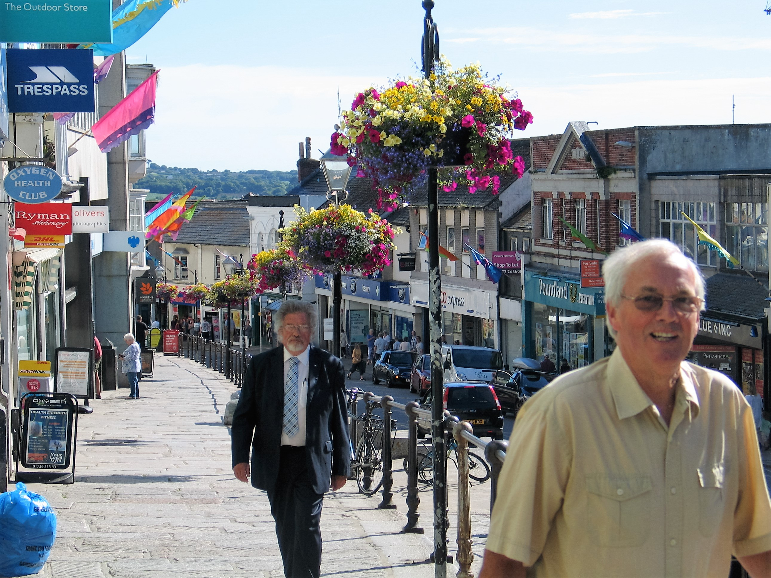 The bustle of the pavement lined with flowers in Penzance