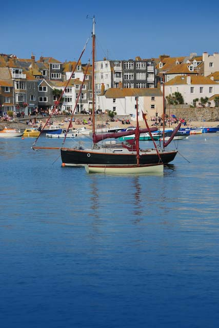 A sailingboat in st ives on a sunny day but there is still lots to see in the rain