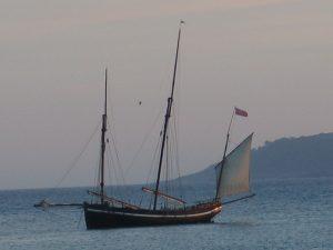 "The Luggger ""Grayhound"" moored beside St michael's Mount at dusk"