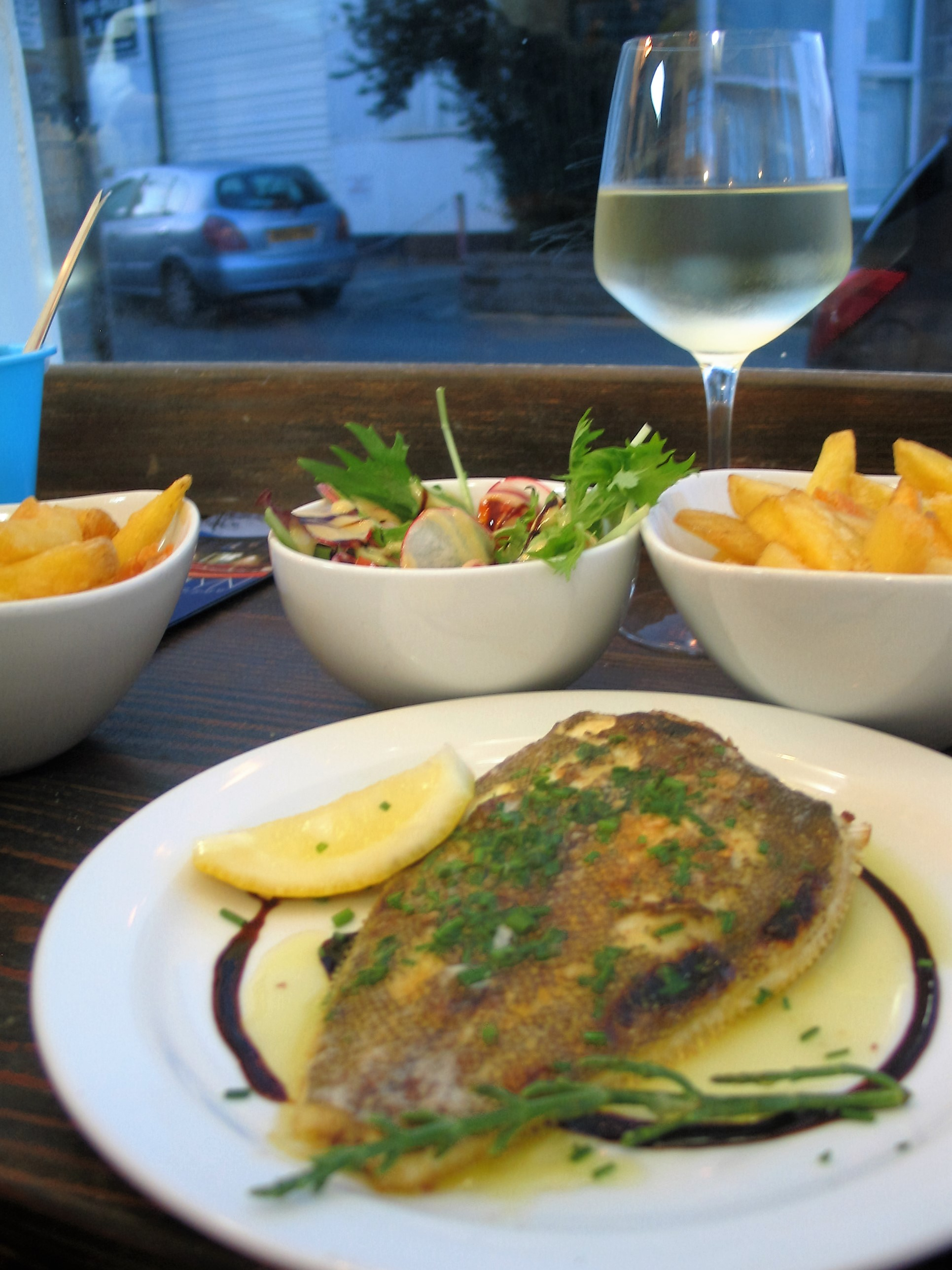 Mounts bay Sole accompanied by chips and salad and a glass of chilled wine of ocurse