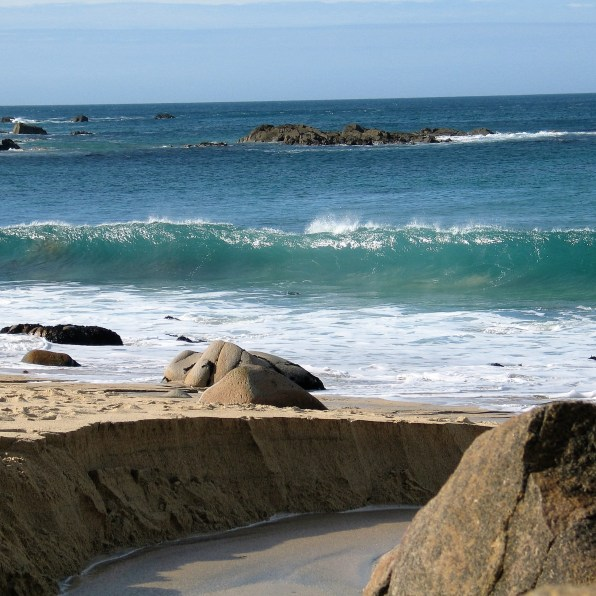 A stream carves its path to the sea at Portheras Cove
